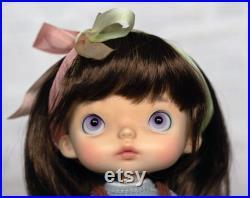 Custom vinyl doll.
