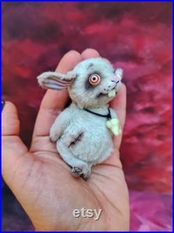 Cute toothy white zombie rabbit, Teddy rabbit. Plush rabbit. White teddy hare. Tooth keeper. glowing teeth, glowing eyes, dead. art toy