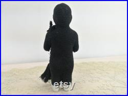 Frozen Charlie antique china doll in original black crochet chimney sweeper suit with tools, made 1850 1920 in Germany, 5 porcelain doll