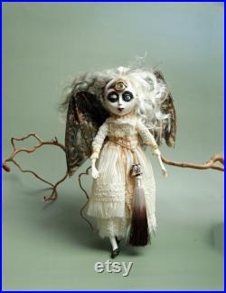Halloween spooky art doll. Creepy vampire wall hanging bat figurine for gothic home decor.
